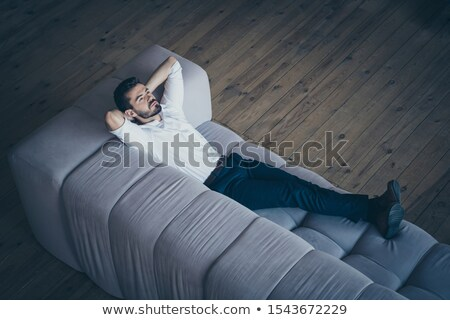 Handsome man relaxing in calm place Stock photo © konradbak