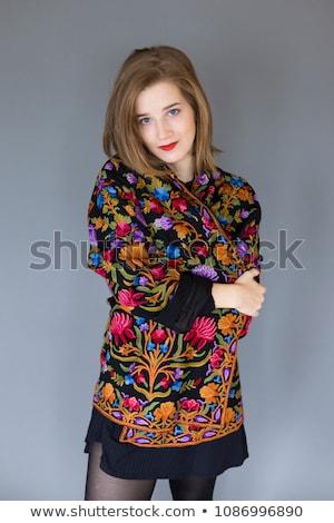 Mooie jonge blond zwarte minirok geïsoleerd Stockfoto © acidgrey