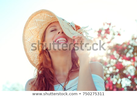 redhead women in hat stock photo © massonforstock