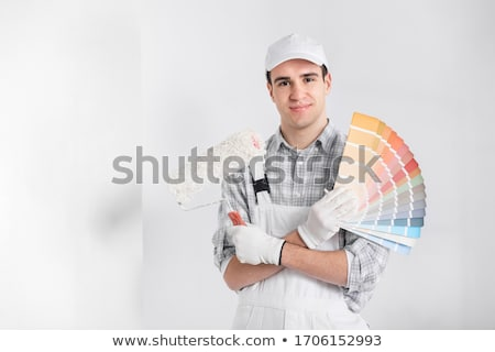 Friendly decorator with a roller Stock photo © photography33
