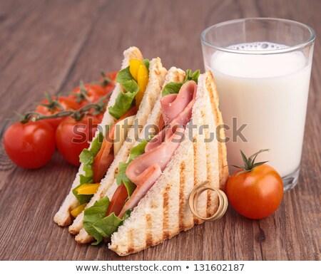 трехслойный бутерброд молоко стекла фон завтрак томатный Сток-фото © M-studio