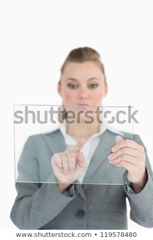 Blonde businesswoman touching glass pane Stock photo © wavebreak_media