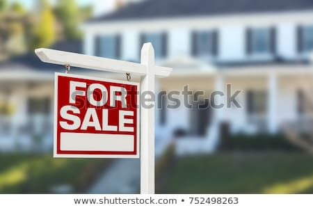 Sold Home For Sale Sign And House Stock photo © Lightsource