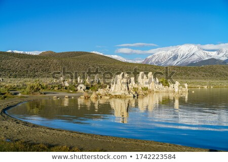 Tufa formations in Mono Lake, California reflected in water Stock photo © snyfer