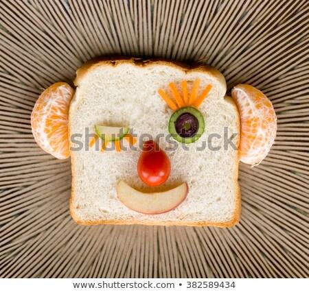 Mosolygós arc kenyér papír boldog haj gyümölcs Stock fotó © kawing921