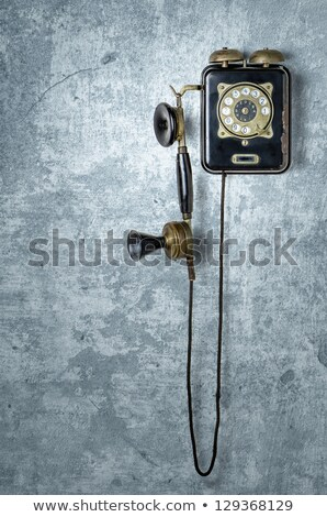 Antique Telephone On A Grungy Blue Wall Photo stock © Zerbor