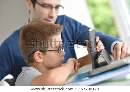 30 years old man playing with eyeglasses Stock photo © aladin66