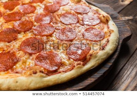 bütün · pepperoni · pizza · kırmızı · masa · örtüsü · bo - stok fotoğraf © stevanovicigor