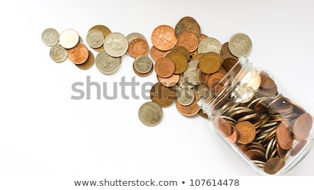 a jar full of coins on white background stock photo © kirill_m