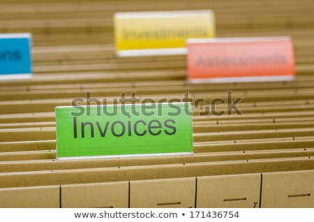 Hanging file folder labeled with Invoices Stock photo © Zerbor