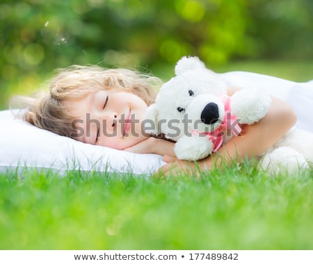 baby teddy bear sleeping on grass stock photo © balasoiu