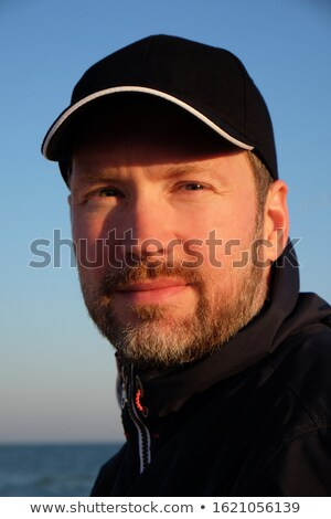 Attractive young man posing outdooor  Stock photo © feedough