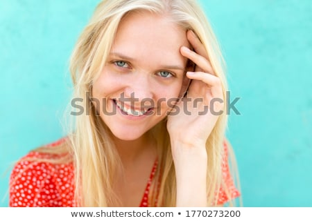 blond female smiling at the camera stock photo © dash