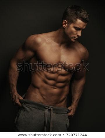 красивый мужчина мускулистое тело позируют серый человека счастливым Сток-фото © deandrobot