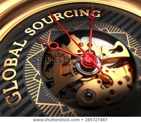 Global Sourcing on Black-Golden Watch Face. Stock photo © tashatuvango