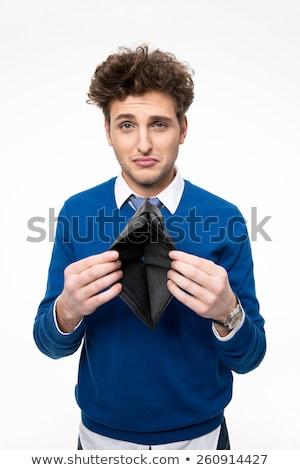 Zaklatott fiatalember tart pénztárca fehér kéz Stock fotó © deandrobot