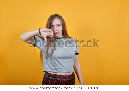 hands showing thumbs up over rainbow background stock photo © dolgachov
