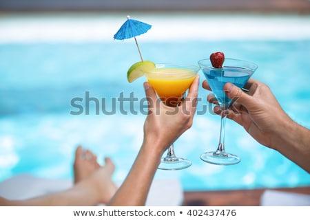 Kadın içme kokteyl yüzme havuzu tam uzunlukta portre Stok fotoğraf © deandrobot