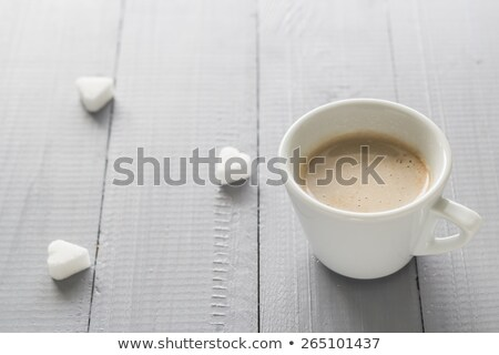 Stock photo: Coffee Cup With Milk And Sugar Cubes Scattered
