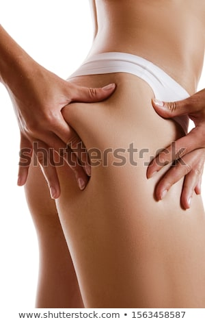 woman showing cellulite on her belly stock photo © nenetus