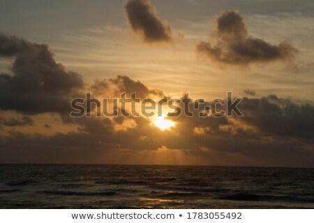 рассвет Восход морем небе облака судно Сток-фото © Leonardi