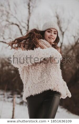 Girl in winter park rejoices first snow Stock photo © orensila