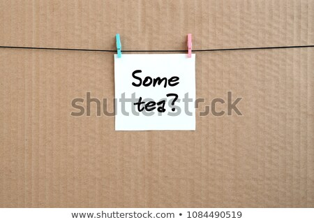 Tea - White Letters Hanging on the Ropes. Stock photo © tashatuvango