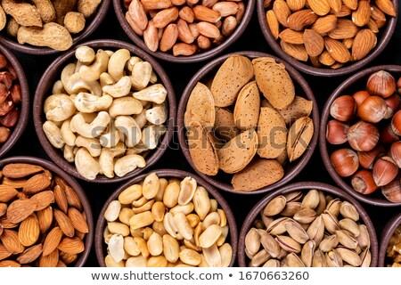 Egészséges étel mogyoró mandulák kesudió mazsola aszalt Stock fotó © mcherevan