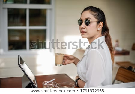 Businesswoman sitting thinking at a restaurant Stock photo © dash