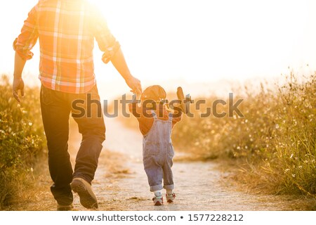father and son looking the airplane at sunset stock photo © adrenalina