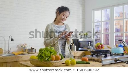 woman checking recipe in kitchen stock photo © nyul