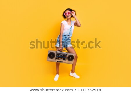full length portrait of a smiling woman holding record player stock photo © deandrobot