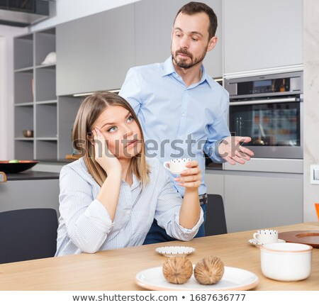 Squabbled couple in stylish apartment Stock photo © konradbak