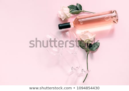 Glass of red wine and rose flower Stock photo © Leftleg
