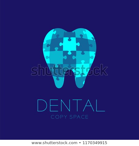 tooth treatment symbol in the puzzle shapes stock photo © tefi