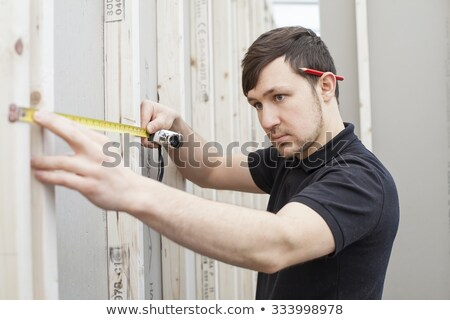 Man Using Measuring Tape At Home Stock photo © AndreyPopov