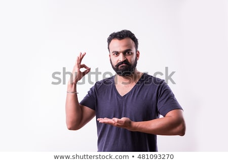 happy indian man showing thumbs up over white Stock photo © dolgachov