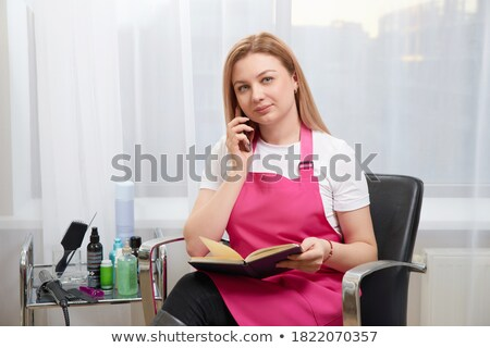 Woman in parlour talking by phone Stock photo © dash