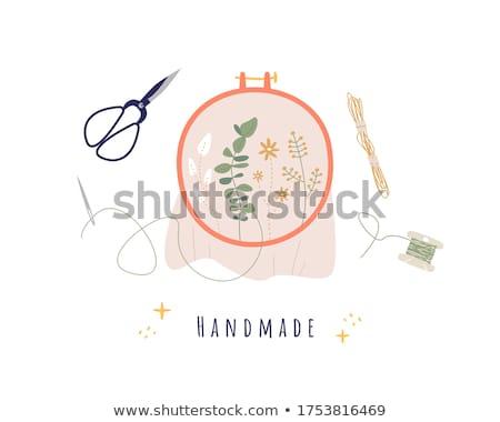 Needlework design on embroidery hoops. Stock photo © yopixart