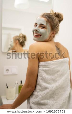 Tattooed girl posing in bathroom Stock photo © bezikus