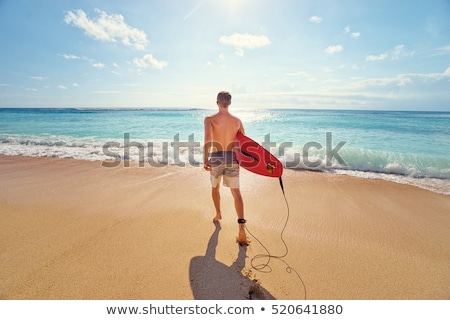 Homem prancha de surfe caminhada costa praia água Foto stock © wavebreak_media