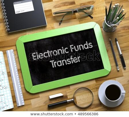 electronic funds transfer on small chalkboard 3d stock photo © tashatuvango