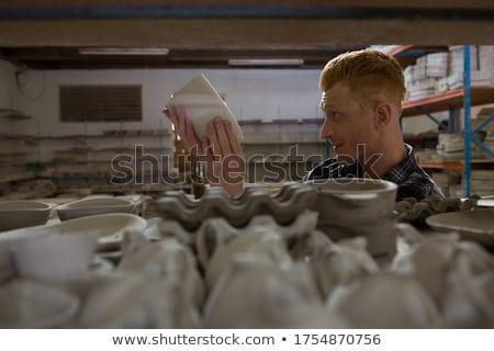 Male potter examining a earthenware equipment Stock photo © wavebreak_media
