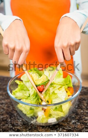 Young woman tossing a salad Stock photo © IS2