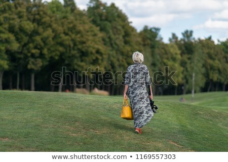 Mature woman mowing lawn Stock photo © IS2