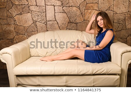 Woman lying on sofa looking at viewer Stock photo © IS2