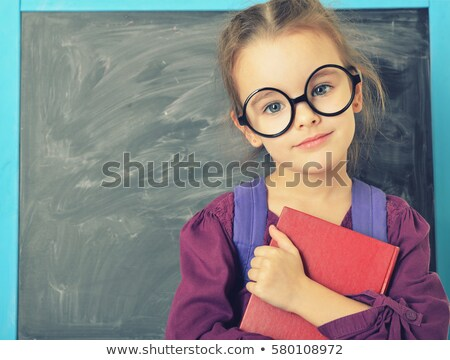 5 years old girl holding a book stock photo © is2