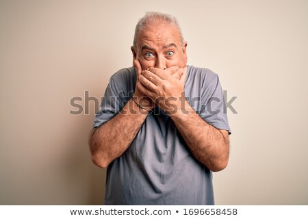 Scared man covered with hands Stock photo © studiostoks
