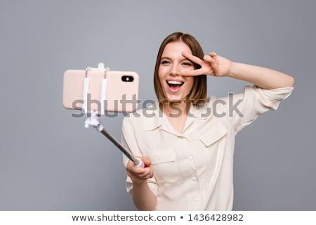 Młoda kobieta mówić telefonu zwycięstwo podpisania biały Zdjęcia stock © feedough