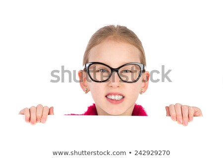 portrait of an excited little girl holding sheet of paper stock photo © deandrobot